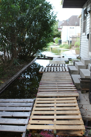 Mid City Neighbors Battling Lake Of Floodwater On