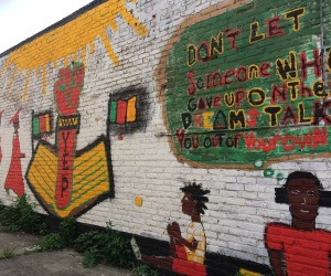 As the Mid-City Security District tries to eradicate some graffiti, local residents defend it as artwork