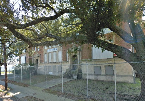 A local developer plans to turn the old McDonogh 31 school into high-end apartments and condos (Google Maps).