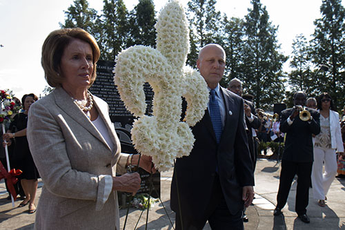 House minority leader Nacy Pelosi, left, and New Orleans Mayor Mitch Landrieu, right, bring a wreath to one of the monuments. Each monument was dedicated to those bodies unclaimed after Katrina. (Zach Brien, MidCityMessenger.com)