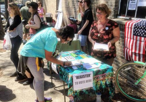 Caption: The Green Party of New Orleans conducts a voter registration drive at Second Line Brewing on Saturday after the Tenth Annual Hike of the Laffitte Greenway (Photo by Bart Everson).