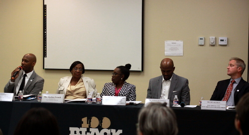 OPSB Superintendent Henderson Lewis Jr. (left) speaks on a panel with Thelma French, Deidre Johnson-Burel, Jamar McKneely and Ben Kleban on Tuesday night. (Robert Morris, UptownMessenger.com)