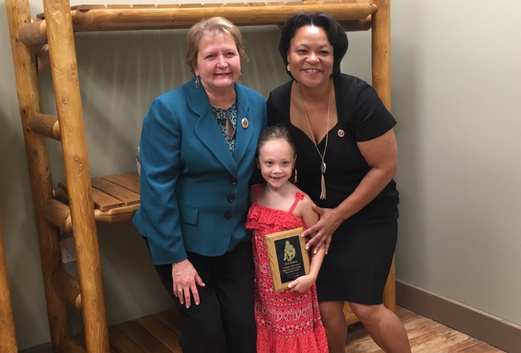 Councilmembers Guidry and Cantrell pose with Miss Zoe Evans, who helped raise $5,000 for Camp Bow Wow Mid-City's philanthropy programs. (MidCityMessenger.com)