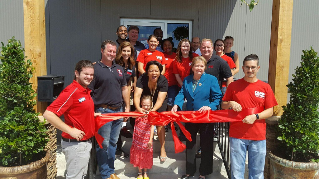 Councilmembers Latoya Cantrell and Susan Guidry help cut the ribbon for Camp Bow Wow in Mid-City (Courtesy of Councilmember Susan G. Guidry)