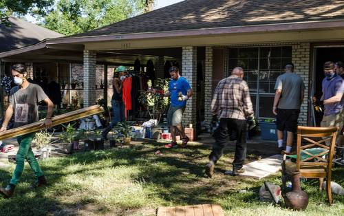 Members of the Green Party of New Orleans help salvage items and gut a house in Denham Springs, La. (photo courtesy of Miranda Murray)