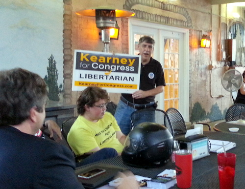 Howard Kearney visits with the Libertarian Party of New Orleans on Monday evening. (Robert Morris, MidCityMessenger.com)