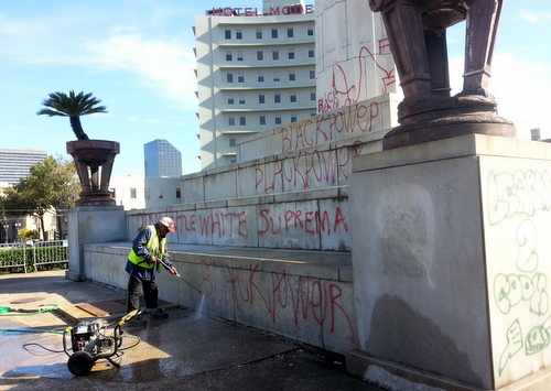 "An employee of the City of New Orleans begins erasing the ""Black Power"" slogan from the monument to Confederate Gen. Robert E. Lee on Thursday, Nov. 10, following protests over the election of Donald J. Trump. (Robert Morris, UptownMessenger.com)"