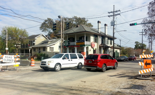 Motorists pass through the Jefferson Avenue intersection on Freret Street, which reopened on Friday after being closed four months. (Robert Morris, UptownMessenger.com)