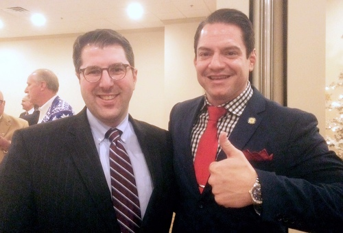 Joe Giarrusso and Brian Trascher smile at the holiday event. (photo by Danae Columbus for UptownMessenger.com)