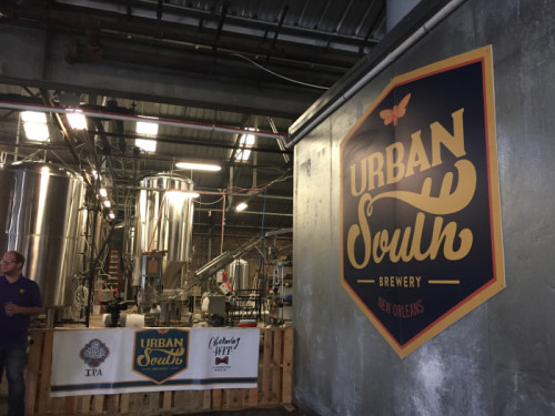 The warehouse district is a good fit for the breweries since they require a lot of space for the tanks. On Friday Nov. 11, Urban South Brewery celebrated the expansion of their brewery after being in business for 7 months. (Photo by Dannielle Garcia).