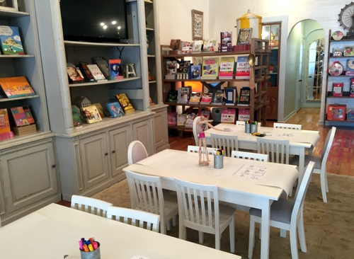 Tables with paper cloths are set up on the upper level of the store so children can draw. The French Library opened in June on Magazine Street.  (Photo by Haley Pegg)