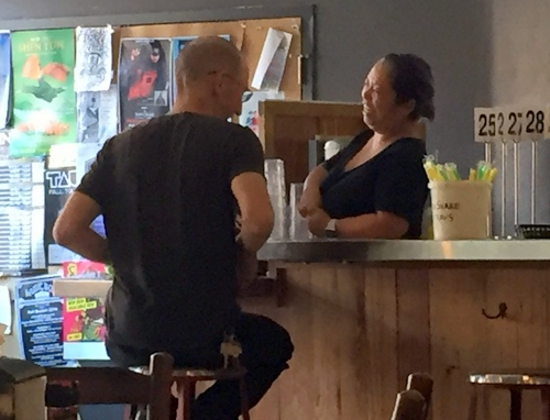 Amy Doan chats with longtime customer, Benjamin Strange, as he waits for his food. (Photo by Danielle Carbonari)