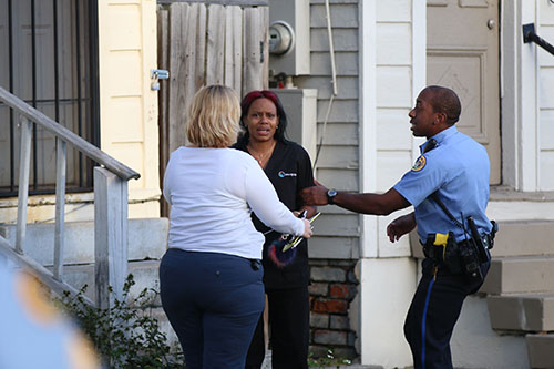 NOPD officers remove a woman from the crime scene in the 2800 block of Orleans avenue. One man was shot in the incident on Tuesday afternoon. (Zach Brien, MidCityMessenger.com)